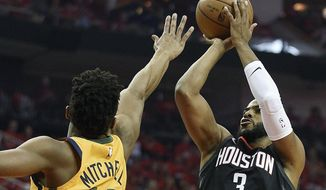 Houston Rockets guard Chris Paul (3) shoots over Utah Jazz guard Donovan Mitchell during the first half in Game 1 of an NBA basketball second-round playoff series, Sunday, April 29, 2018, in Houston. (AP Photo/Eric Christian Smith)