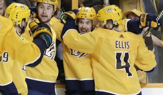 Nashville Predators left wing Viktor Arvidsson (33), of Sweden, celebrates with Roman Josi (59), of Switzerland; Filip Forsberg (9), also of Sweden; and Ryan Ellis (4) after scoring a goal against the Winnipeg Jets during the second period in Game 2 of an NHL hockey second-round playoff series Sunday, April 29, 2018, in Nashville, Tenn. (AP Photo/Mark Humphrey)
