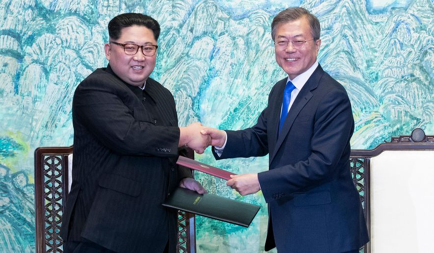FILE - In this April 27, 2018 file photo, North Korean leader Kim Jong Un, left, and South Korean President Moon Jae-in shake hands after signing on a joint statement at the border village of Panmunjom in the Demilitarized Zone, South Korea. Seoul says North Korean leader Kim plans to shut down the country's nuclear test site in May and reveal the process to experts and journalists from the United States and South Korea. Seoul's presidential spokesman Yoon Young-chan said Sunday, April 29,  Kim made the comments during his summit with South Korean President Moon Jae-in on Friday.(Korea Summit Press Pool via AP)