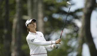 Lydia Ko, of New Zealand, follows her approach shot to the fifth green of the Lake Merced Golf Club during the final round of the LPGA Mediheal Championship golf tournament Sunday, April 29, 2018, in Daly City, Calif. (AP Photo/Eric Risberg)