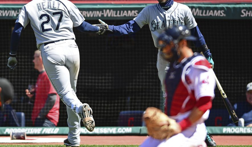 Seattle Mariners' Ryon Healy, left, is congratulated by Dee Gordon after Healy hit a solo home run in the sixth inning of a baseball game against the Cleveland Indians, Sunday, April 29, 2018, in Cleveland. (AP Photo/David Dermer)