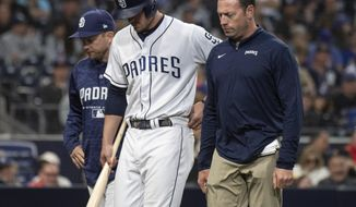 San Diego Padres' Wil Myers, center, exits with an injury during the fifth inning of a baseball game against the New York Mets in San Diego, Saturday, April 28, 2018. (AP Photo/Kyusung Gong)