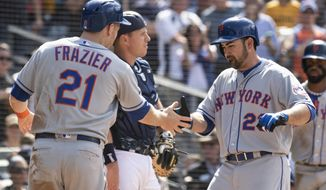 New York Mets' Adrian Gonzalez, right, celebrates his three-run homer with New York Mets' Todd Frazier, left, as San Diego Padres catcher A.J. Ellis looks on during the seventh inning of a baseball game against the San Diego Padres in San Diego, Sunday, April 29, 2018. (AP Photo/Kyusung Gong)