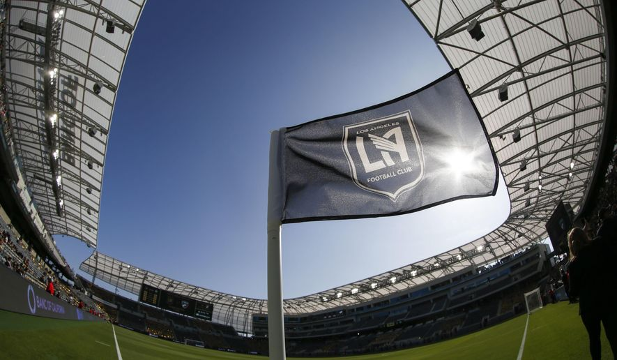 In this photo taken with a fisheye lens, a flag flies at the new Banc of California Stadium prior to an MLS soccer game between Los Angeles FC and the Seattle Sounders in Los Angeles, Sunday, April 29, 2018. (AP Photo/Ringo H.W. Chiu)