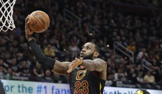 Cleveland Cavaliers' LeBron James (23) drives to the basket against Indiana Pacers' Myles Turner (33) in the first half of Game 7 of an NBA basketball first-round playoff series, Sunday, April 29, 2018, in Cleveland. (AP Photo/Tony Dejak)