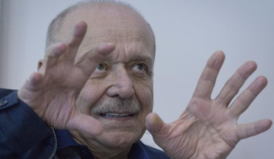 In this photo made Sunday, April 22, 2018, Yasser Abed Rabbo, 73, a decade Palestinian Liberation Organization Number two, who was sidelined by Abbas in 2015, talks to the Associated press during an interview in his office at the PLO headquarters, in the West Bank city of Ramallah. (AP Photo/Nasser Nasser)