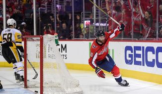 Washington Capitals right wing Brett Connolly (10) celebrates his goal during the second period in Game 2 of an NHL second-round hockey playoff series as Pittsburgh Penguins defenseman Kris Letang (58) skates away, Sunday, April 29, 2018, in Washington. (AP Photo/Nick Wass)