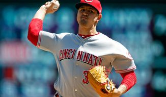 Cincinnati Reds' pitcher Tyler Mahle throws against the Minnesota Twins in the first inning of a baseball game Sunday, April 29, 2018, in Minneapolis. (AP Photo/Jim Mone)