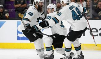 San Jose Sharks' Logan Couture (39) celebrates after scoring the game-winning goal against the Vegas Golden Knights during the second overtime of Game 2 of an NHL hockey second-round playoff series Saturday, April 28, 2018, in Las Vegas. Sharks' Brent Burns (88) and Tomas Hertl (48) celebrate with Couture. San Jose won 4-3. (AP Photo/John Locher)