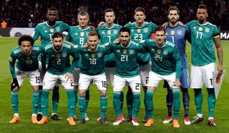 In this photo taken on Tuesday, March 27, 2018, German players pose prior to the international friendly soccer match between Germany and Brazil in Berlin. (AP Photo/Michael Sohn)