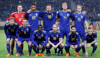 In this image taken on Tuesday, March 27, 2018 Sweden's national soccer team poses before an international friendly soccer match between Romania and Sweden on the Ion Oblemenco stadium in Craiova, Romania. (AP Photo/Vadim Ghirda)