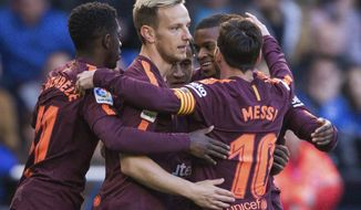 Barcelona's Philippe Coutinho, background center, is congratulated by teammates after scoring a goal during a Spanish La Liga soccer match between Deportivo and Barcelona at the Riazor stadium in A Coruna, Spain, Sunday, April 29, 2018. (AP Photo/Lalo R. Villar)