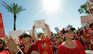 FILE - In this April 27, 2018 file photo, teachers rally outside the Capitol in Phoenix, in a series of strikes across the nation over low teacher pay. The president of the American Federation of Teachers is coming to Phoenix on Monday to support Arizona teachers' call for additional school funding. Randi Weingarten will be holding a news conference next to the state Capitol and also she is scheduled to speak at a rally. (AP Photo/Matt York, File)