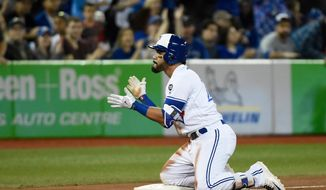 Toronto Blue Jays' Devon Travis reacts after hitting a triple against the Boston Red Sox during the seventh inning of a baseball game in Toronto on Thursday, April 26, 2018. (Nathan Denette/The Canadian Press via AP)