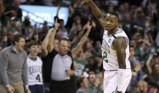 Boston Celtics guard Terry Rozier (12) celebrates his three-point shot against the Philadelphia 76ers in the first quarter of Game 1 of an NBA basketball second-round playoff series, Monday, April 30, 2018, in Boston. (AP Photo/Elise Amendola)