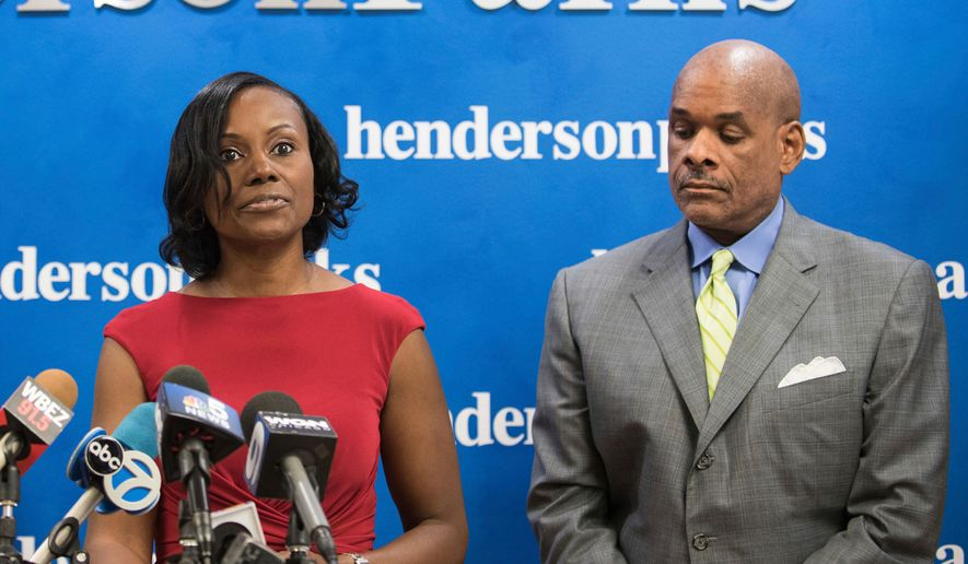 FILE - In this Sept. 22, 2016, file photo, Rhonda Crawford stands alongside her attorney Victor Henderson in Chicago, as she addresses allegations that she impersonated a judge. A coroner's office said Friday, April 27, 2018, that Crawford, a former law clerk slated for trial to begin Monday, April 30 for impersonating a judge in 2016, was found dead at her Calumet City, Ill., home. A Friday daily ledger of the Cook County Medical Examiner's Office says Crawford was pronounced dead Thursday, April 26. (Max Herman/Chicago Sun-Times via AP, File)