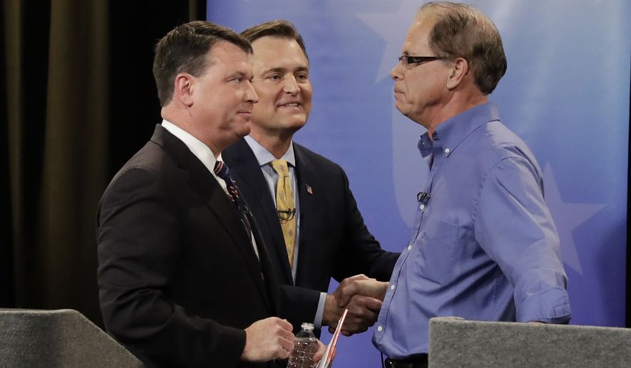 Senate candidates Todd Rokita, , from left, Luke Messer and Mike Braun speak with each other following the Indiana Republican Senate Primary Debate, Monday, April 30, 2018, in Indianapolis. (AP Photo/Darron Cummings, Pool)