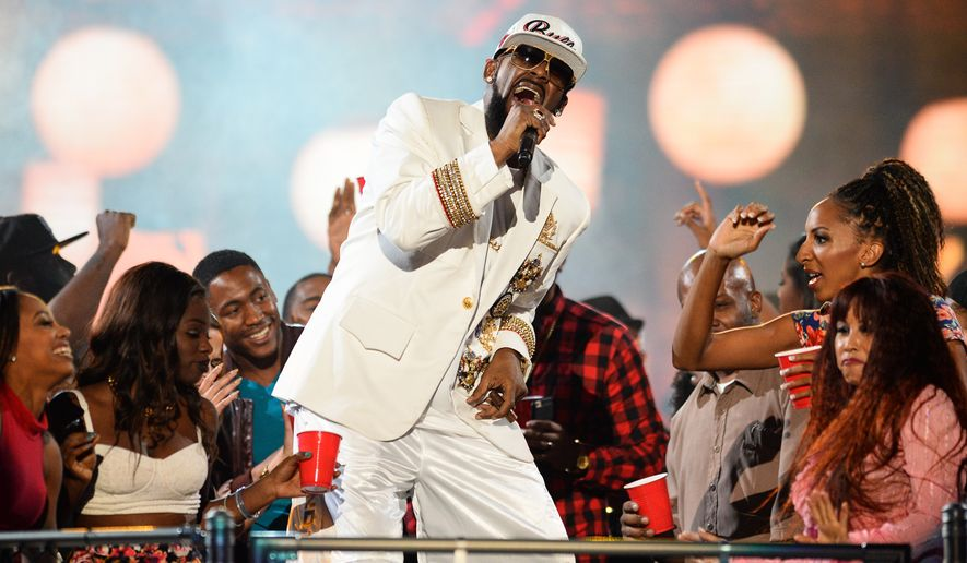 R. Kelly performs during the 2015 Soul Train Awards at the Orleans Arena on Friday, Nov. 6, 2015, in Las Vegas. (Photo by Al Powers/ Powers Imagery/Invision/AP)