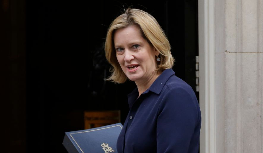 In this Thursday, Sept. 21, 2017, file photo Britain's Home Secretary Amber Rudd looks at the media as she arrives for a Cabinet meeting at 10 Downing Street, in London. Britain's interior minister resigned Sunday amid a scandal over authorities' mistreatment of long-term U.K. residents wrongly caught up in a government drive to reduce illegal immigration. (AP Photo/Alastair Grant, File)