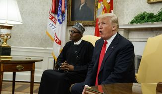 President Donald Trump meets with Nigerian President Muhammadu Buhari in the Oval Office of the White House, Monday, April 30, 2018, in Washington. (AP Photo/Evan Vucci)