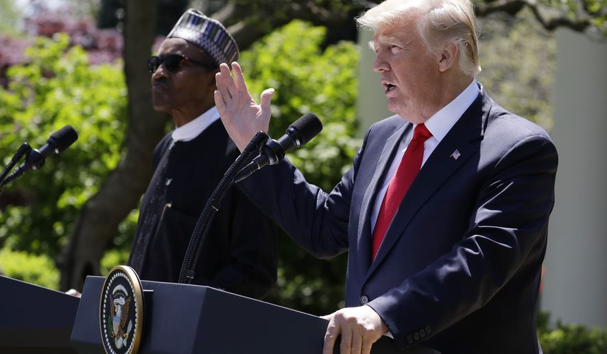 President Donald Trump speaks during a news conference with Nigerian President Muhammadu Buhari in the Rose Garden of the White House, Monday, April 30, 2018, in Washington. (AP Photo/Evan Vucci)