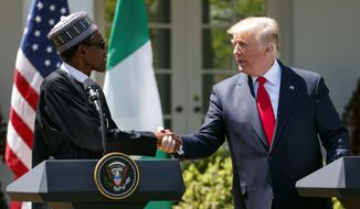 President Donald Trump shakes hands with Nigerian President Muhammadu Buhari during a news conference in the Rose Garden of the White House in Washington, Monday, April 30, 2018.(AP Photo/Carolyn Kaster)