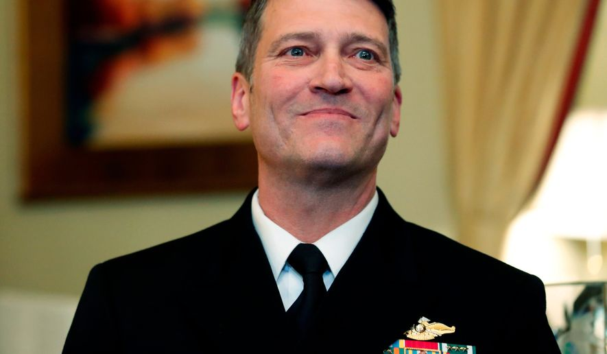 U.S. Navy Rear Adm. Ronny Jackson, M.D., sits before a meeting on Capitol Hill in Washington on April 16, 2018. (Associated Press) ** FILE **
