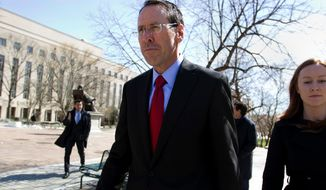 FILE - In this March 22, 2018, file photo, AT&T CEO Randall Stephenson leaves the federal courthouse, in Washington. The U.S. government pleaded its case Monday, April 30, for blocking AT&T from absorbing Time Warner, saying it would hurt consumers as a big antitrust trial crept toward its end and a decision by a federal judge. (AP Photo/Jose Luis Magana, File)