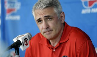FILE - In this May 5, 2014, file photo, Carolina Hurricanes general manager Ron Francis takes questions from members of the media during a news conference in Raleigh, N.C. The Carolina Hurricanes have terminated the contract of demoted general manager and Hall of Fame player Ron Francis. The Hurricanes announced the move Monday, April 30,2018, nearly two months after Francis was reassigned to another front-office position while the team began a search for a new GM that will report directly to new owner Tom Dundon. (AP Photo/Gerry Broome, File)