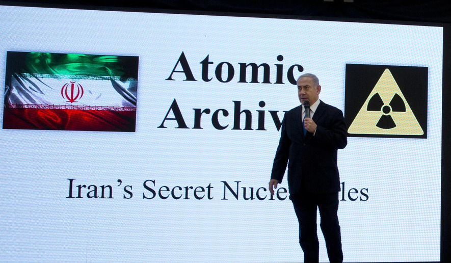 "Israeli Prime Minister Benjamin Netanyahu presents material on Iranian nuclear weapons development during a press conference in Tel Aviv, Monday, April 30 2018. Netanyahu says his government has obtained ""half a ton"" of secret Iranian documents proving the Tehran government once had a nuclear weapons program. Calling it a ""great intelligence achievement,"" Netanyahu said Monday that the documents show that Iran lied about its nuclear ambitions before signing a 2015 deal with world powers. (AP Photo/Sebastian Scheiner)"