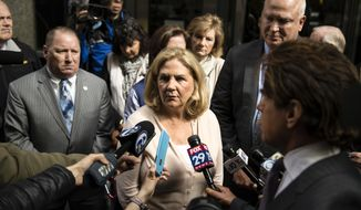 Maureen Faulkner, the widow of slain Philadelphia police officer Daniel Faulkner, speaks with members of the media after a hearing for Mumia Abu-Jamal, convicted in the 1981 murder of her husband, in Philadelphia, Monday, April 30, 2018. Lawyers for Abu-Jamal were in court asking a judge to vacate his previous failed appeals attempts, so he can again appeal his case. (AP Photo/Matt Rourke)