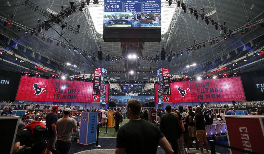 Fans gather on the floor during the NFL football draft at AT&T Stadium in Arlington, Texas, Saturday, April 28, 2018. (Jae S. Lee/The Dallas Morning News via AP)