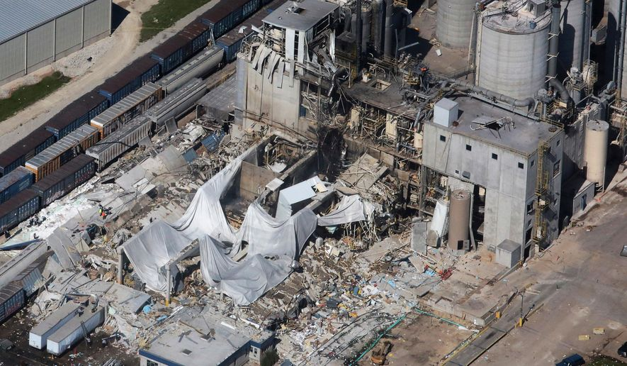 FILE - In this June 1, 2017 file photo, part of the Didion Milling Plant in Cambria, Wis., lies in ruins following an explosion. Federal safety inspectors say an air filter blew off a corn grinding device shortly before a deadly explosion demolished the southern Wisconsin corn mill last summer. Officials with the U.S. Chemical Safety and Hazard Investigation Board held a news conference Monday, April 30, 2018, to discuss preliminary findings from their investigation into the blast at Didion Milling Plant in Cambria on May 31. Five workers were killed and 14 were injured.(John Hart/Wisconsin State Journal via AP, File)