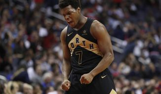 Toronto Raptors guard Kyle Lowry celebrates late in the second half of Game 6 of the team's NBA basketball first-round playoff series against the Washington Wizards, Friday, April 27, 2018, in Washington. The Raptors won 102-92. (AP Photo/Alex Brandon)