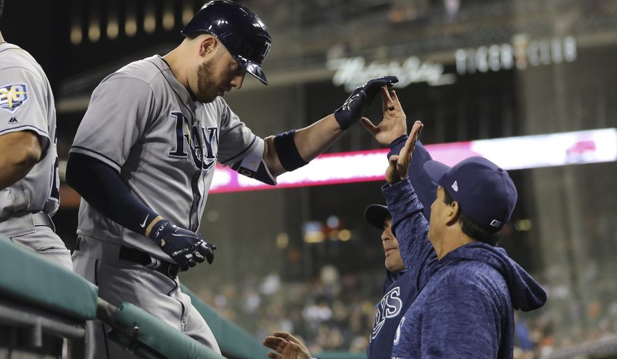 Tampa Bay Rays' C.J. Cron is greeted in the dugout after hitting a two-run home run during the ninth inning of a baseball game against the Detroit Tigers, Monday, April 30, 2018, in Detroit. (AP Photo/Carlos Osorio)