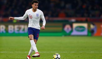 In this photo taken on Friday, March 23, 2018, England's Dele Alli controls the ball during the international friendly soccer match between the Netherlands and England at the Amsterdam ArenA in Amsterdam, Netherlands. (AP Photo/Peter Dejong)