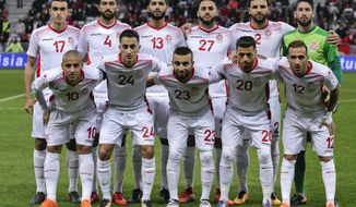 In this photo taken on Tuesday, March 27, 2018, Tunisia's national soccer team poses before a friendly soccer match between Tunisia and Costa Rica at the Allianz Riviera stadium in Nice, southern France. (AP Photo/Claude Paris)