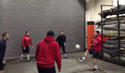 A group of Washington Capitals players including Evgeny Kuznetsov (far left) and Devante Smith-Pelly (front-center) kicks around a soccer ball before a game on March 6, 2018. (Video screenshot via Twitter / @Capitals)