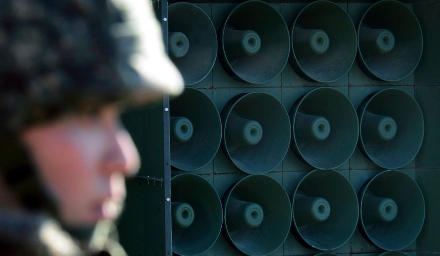 In this Friday, Jan. 8, 2016, file photo, a South Korean army soldier stands near the loudspeakers near the border area between South Korea and North Korea in Yeoncheon, South Korea. (Lim Tae-hoon/Newsis via AP, File)