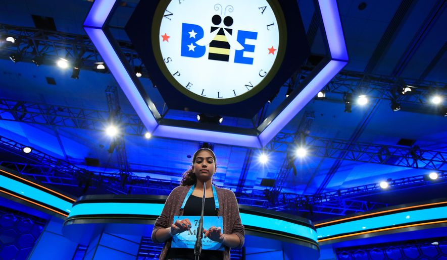 FILE - In this June 1, 2017 file photo, Mira Dedhia, 13, from Western Springs, Ill., uses an imaginary keyboard to correctly spell her word during the finals of the 90th Scripps National Spelling Bee, in Oxon Hill, Md.   A new wild-card program has expanded the field at the Scripps National Spelling Bee from fewer than 300 spellers to more than 500. (AP Photo/Manuel Balce Ceneta)