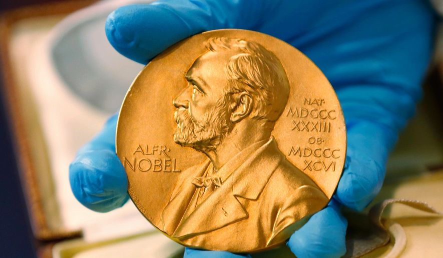 FILE- In this file photo dated Friday, April 17, 2015, a national library employee shows the gold Nobel Prize medal awarded to the late novelist Gabriel Garcia Marquez, in Bogota, Colombia. For the first time since 1943, there's a notable chance that no Nobel Prize for Literature will be awarded this year, it is revealed Monday April 30, 2018, as the Swedish Academy, which chooses the Nobel Literature winner, is embroiled in sex abuse and financial crimes scandals. (AP Photo/Fernando Vergara, FILE)