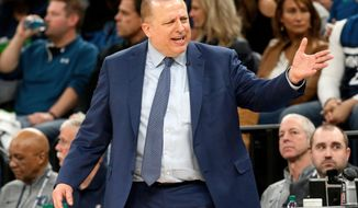 FILE - In this April 21, 2018, file photo, Minnesota Timberwolves head coach Tom Thibodeau directs his team against the Houston Rockets in the first half during Game 3 of an NBA basketball first round playoff series in Minneapolis. Thibodeau will enter his third season with the Wolves, focused on trying to help the team improve 3-point shooting and defense. (AP Photo/Jim Mone, File)