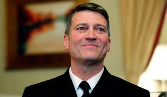 In this April 16, 2018, file photo, U.S. Navy Rear Adm. Ronny Jackson, M.D., sits before a meeting on Capitol Hill in Washington.  (AP Photo/Alex Brandon, File) **FILE**