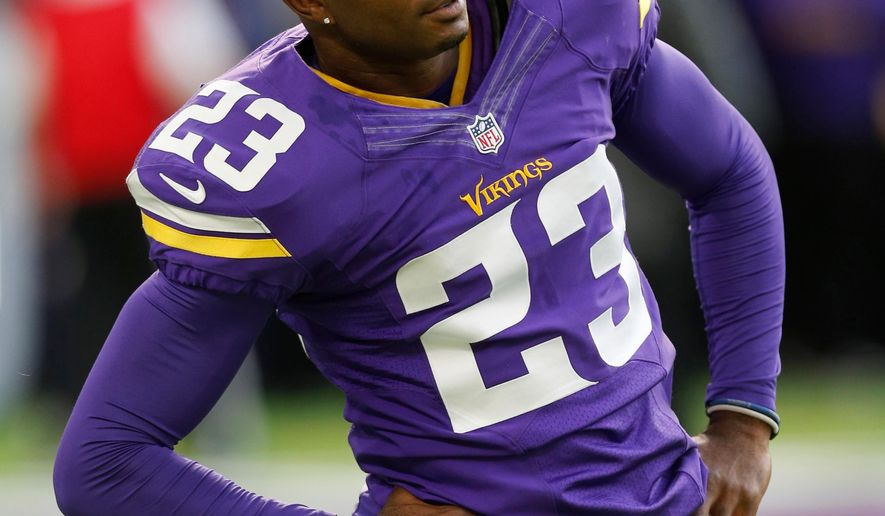 FILE - In this Nov. 6, 2016, file photo, Minnesota Vikings cornerback Terence Newman warms up before an NFL football game against the Detroit Lions, in Minneapolis. The Minnesota Vikings have re-signed cornerback Terence Newman, bringing the NFL's oldest active defensive player back for a 16th season that will begin five days after he turns 40.The move was made Monday, April 30, 2018, with Newman, who has played the last three years with the Vikings. His 42 career interceptions are the most among active players in the league.(AP Photo/Jim Mone, File)