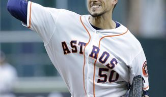 Houston Astros' starting pitcher Charlie Morton (50) throws against the New York Yankees during the first inning of a baseball game Monday, April 30, 2018, in Houston. (AP Photo/Michael Wyke)