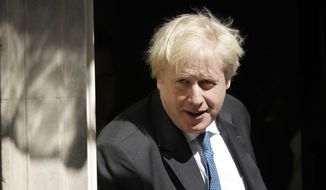 Britain's Foreign Secretary Boris Johnson leaves after a Cabinet meeting at 10 Downing Street in London, Tuesday, May 1, 2018. (AP Photo/Matt Dunham) ** FILE **
