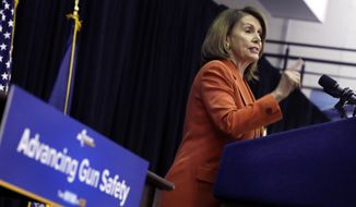 U.S. Rep. Nancy Pelosi, D-Calif., addresses the audience at John Jay College of Criminal Justice during a bill signing ceremony by New York Gov. Andrew Cuomo that removes guns from domestic abusers, Tuesday, May 1, 2018, in New York. (AP Photo/Richard Drew)