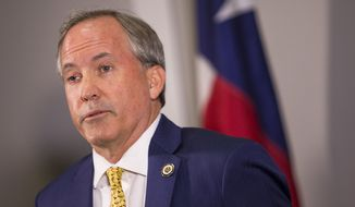 Texas Attorney General Ken Paxton speaks about a lawsuit he filed against the federal government to end DACA during a press conference in Austin, Texas, on May 1, 2018. Paxton is leading a seven-state coalition in the lawsuit. (Nick Wagner/Austin American-Statesman via AP) **FILE**