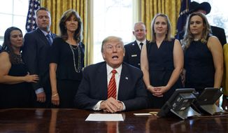 President Donald Trump meets with crew and passengers of Southwest Airlines Flight 1380, including pilot Tammie Jo Shults, third from left, in the Oval Office of the White House in Washington, Tuesday, May 1, 2018. (AP Photo/Carolyn Kaster)