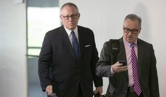 Former Trump campaign official Michael Caputo (left), joined by his attorney Dennis C. Vacco, went to Capitol Hill last week to be interviewed by Senate Intelligence Committee staff investigating Russian meddling in the 2016 presidential election. (Associated Press)
